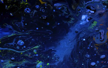 Blue watercolor ink in oil water. Cool trending screensaver. Abstract trending background. Фото со стока