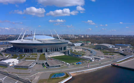 ST. PETERSBURG, RUSSIA - MAY 5, 2020: Aerial view of the Gazprom Arena stadium, known as Zenit Arena. Drone flight over the city. Editorial