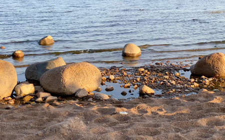 Beautiful sea with small waves. The waves beat against the stones.