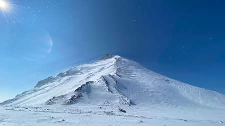 Amazing aerial view of Kamen Volcano. Travel to the Kamchatka Peninsula. Trekking in the Klyuchevskoy volcano park. Reklamní fotografie