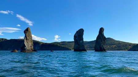 Three Brothers is a group of three pillar-like rocks protruding from the water, located at the entrance to Avachinskaya Bay in Kamchatka. Natural monument and symbol of Petropavlovsk-Kamchatsky.
