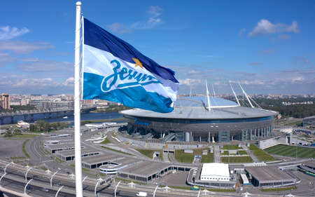 SAINT PETERSBURG, RUSSIA - AUGUST 7, 2020: Aerial view of the flag of Zenit - the main football team of St. Petersburg. Drone flight over the city. Zenit Arena Stadium.