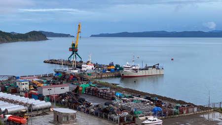 The seaport of Petropavlovsk-Kamchatsky. Beautiful blue sea. Mountains, hills, volcanoes and ships of Kamchatka.