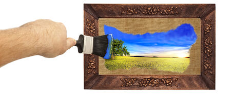 picture of yellow field and blue sky paint with a brush, man draws brush painting, black brush in a man photo