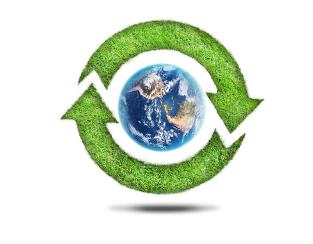 Recycling arrows and blue earth on white background photo