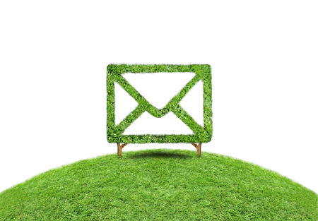Symbol grass email, Conceptual image of green plant shaped like email sign photo