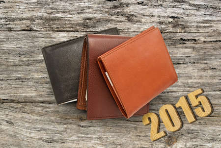 3 5 years: leather wallet with money, some leather purses, three purse with paper money on the table Stock Photo