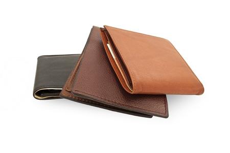 lederen tas, een paar portemonnees op een witte achtergrond, drie verschillende portemonnee