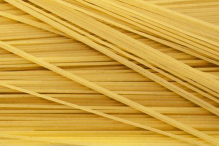 figurative: spaghetti noodles or pasta food background, long spaghetti