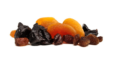 dried fruits, prunes, raisins, dried apricots are isolated on a white background photo
