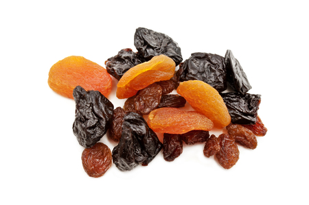 purgative: dried fruits, prunes, raisins, dried apricots are isolated on a white background