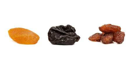 laxative: dried fruits, prunes, raisins, dried apricots are isolated on a white background
