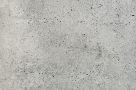 gray concrete wall with numerous cracks and splits, texture concrete blocks