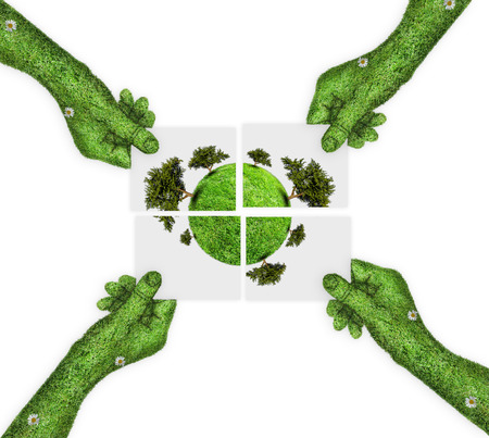 four hands: the concept of green planet Earth is divided into four. four hands holding four parts of the image. hand covered with green grass Stock Photo