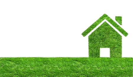Abstracte groene gras huis op een groene weide. Ecology concept