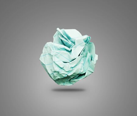 one sheet: Crumpled paper on light background. One sheet of colored crumpled paper with a shadow