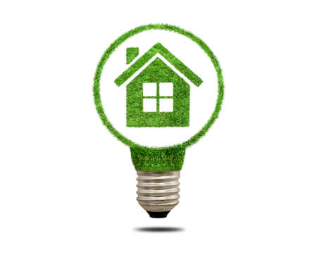 overuse: Green grass light bulb with house inside