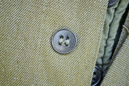 sewn: A round button is sewn to the garment. Button as an element of work clothes Stock Photo
