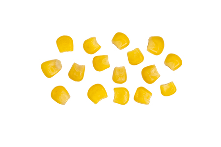 Ripe corn isolated. A few grains of canned corn on a white background. Sweet whole kernel corn 스톡 콘텐츠