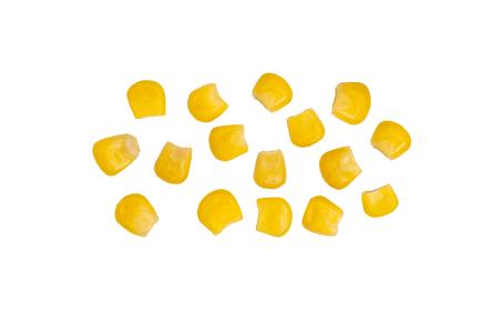 Rijp maïs geïsoleerd. Een paar korrels van ingeblikte maïs op een witte achtergrond. Sweet hele pitgraan