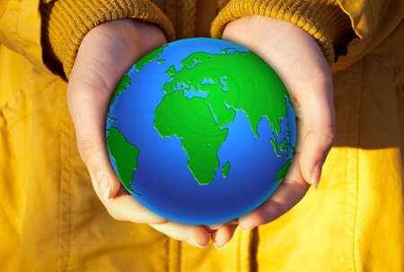 yellow jacket: Earth in the hands. The girl in the yellow jacket, holding a small globe hands.