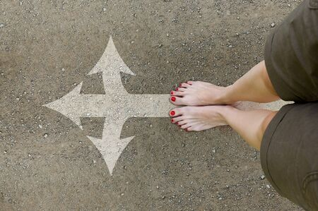 Female feet on the dirt road. Girl stand barefoot on the road with arrow forward. Picture your feet on top. Conceptual photo, point of view perspective.