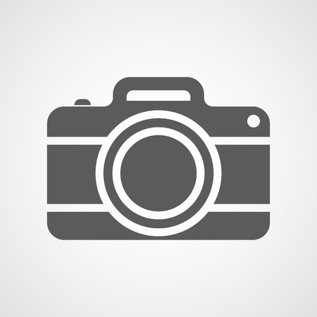 Gray photo camera icon in flat design. Vector illustration. Camera icon isolated on white background.  イラスト・ベクター素材