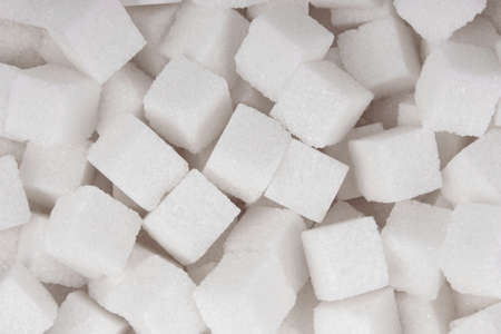 White sugar cubes background top view texture