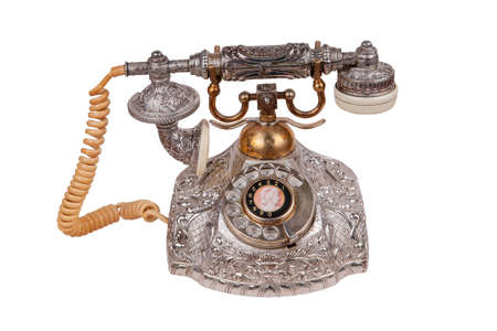 Antique vintage telephone on a white background Stock Photo