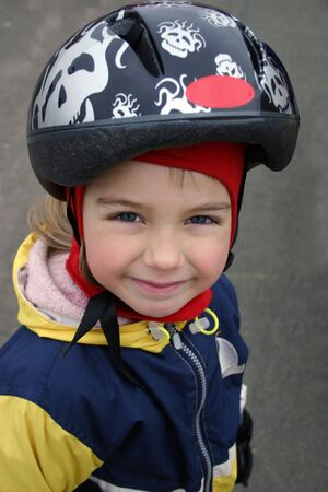 Smiling girl in a helmet.
