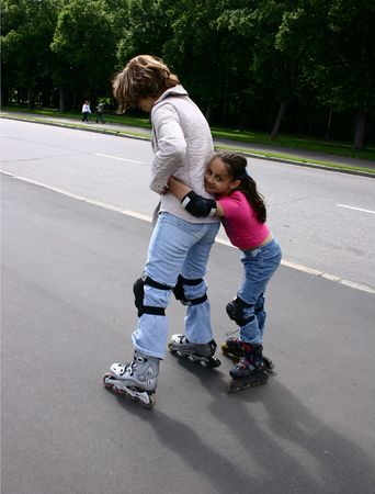 Mother and daughter. Rollers. Stock Photo - 450742