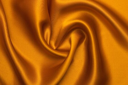 Smooth elegant orange silk can use as background. Stock Photo - 6024946