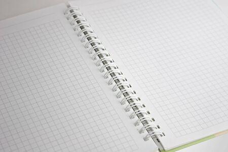 secretarial: Open notebook with a spiral, a diagonal arrangement Stock Photo