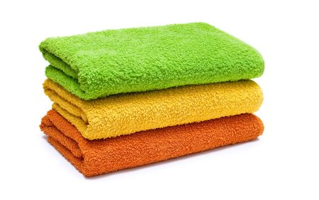 Stacked colorful towels isolated on a white background. photo