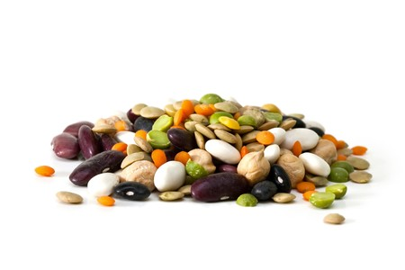 Multicolored mixed dried beans on a white background photo