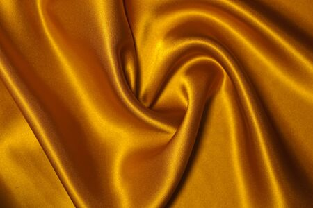 Smooth elegant yellow silk can use as background. Stock Photo - 7054756