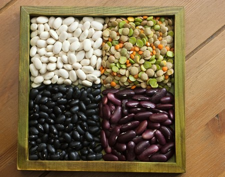 lima beans white beans: Multicolored mixed dried beans in the box Stock Photo