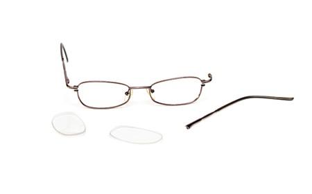 Broken eyeglasses isolated on a white background. photo