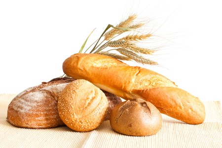 Group of bread and wheat spikes on a white background. photo