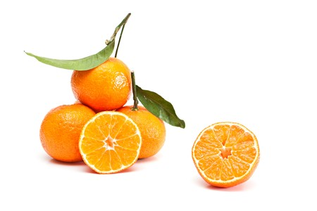 Tangerines with green leaves isolated on white. photo