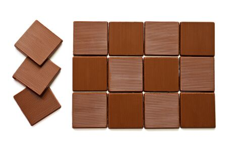 Pieces of chocolate on a white background. photo