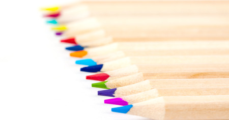 field depth: Different natural colored pencils on white background. Shallow depth of field.