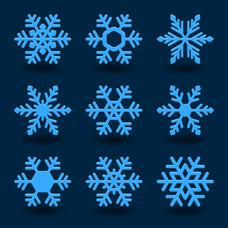 Blue snowflakes and shadow on dark background.