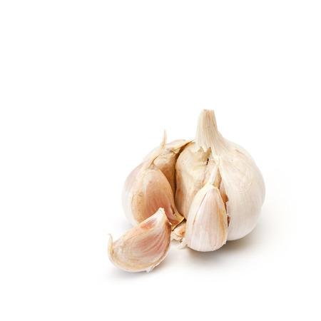 Raw garlic with segments isolated on white background. Stock Photo