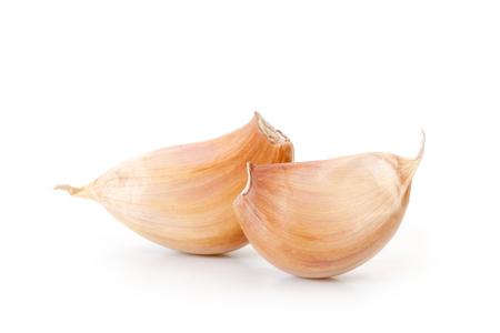 Raw garlic segments on a white background. Stock Photo