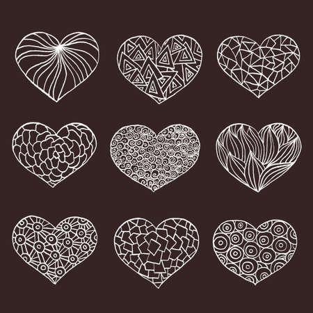 ink drawing: Set of hand drawn hearts. Ornate ink drawing. Trendy retro design elements for valentines day cards, invitations. Vintage vector illustration.