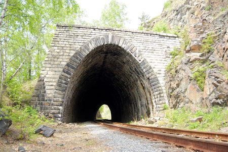 Abandoned stone tunnel over old railroad around the Baikal lake