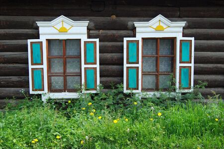 dandelion snow: Two windows of wooden house, close up