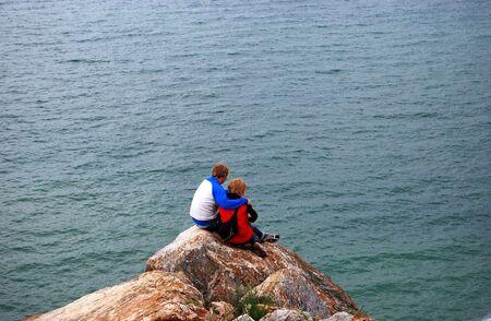 Two people sitting on the slope, Baikal lake Stock Photo - 3296483