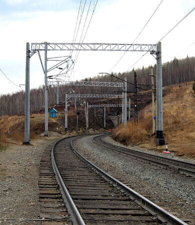 Two old railroads in the middle of Siberian forest photo